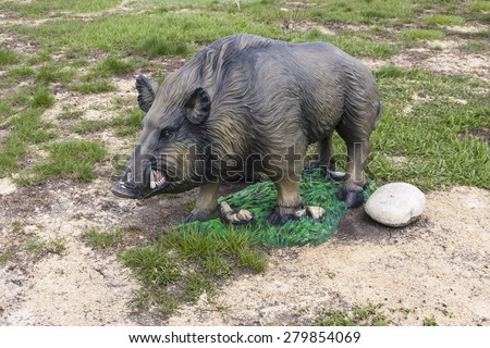 figurine of a wild boar - stock photo