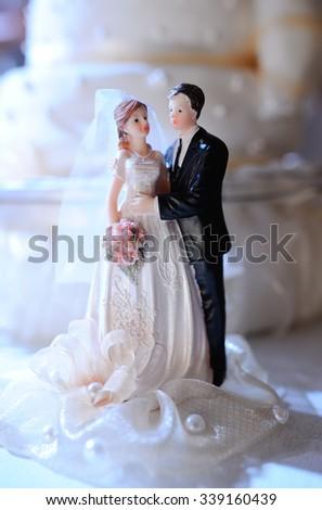 figurine of newlyweds on the wedding cake - stock photo