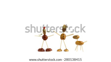 Figurines made of chestnut and acorn and matches representing children with dog isolated on white - stock photo
