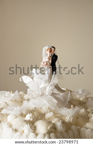Figurines on top of wedding cake. Copy space - stock photo