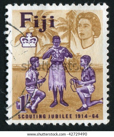 FIJI - CIRCA 1964: Scouts of India FIJI  and Europe Tying Knot, circa 1964. - stock photo
