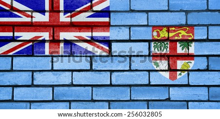 Fijian flag painted on old brick wall texture background - stock photo