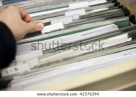 File cabinet with blank file labels ready for your customization - stock photo