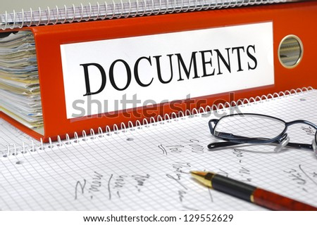file folder in office marked with documents - stock photo