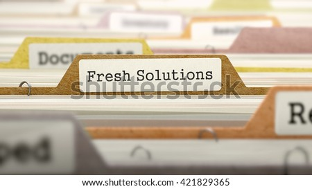 File Folder Labeled as Fresh Solutions in Multicolor Archive. Closeup View. Blurred Image. 3D Render.