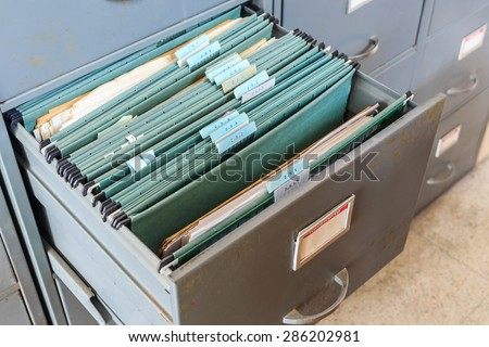 File folders in a filing cabinet - stock photo