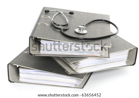 File folders with stethoscope in front of white background - stock photo
