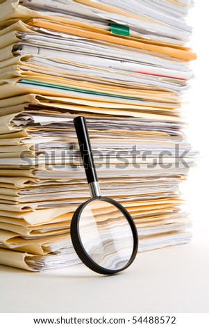 File Stack and Magnifying Glass - stock photo