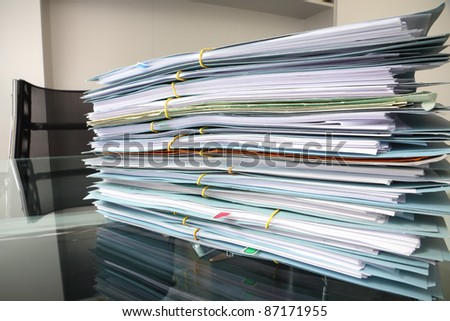 file stack on office desk - stock photo