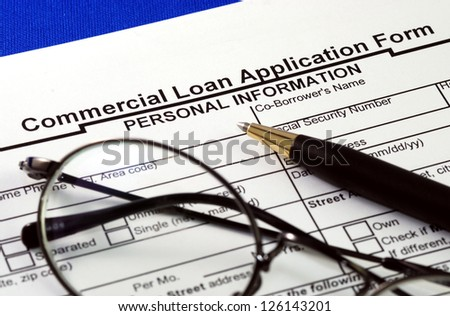 File the commercial loan application isolated on blue