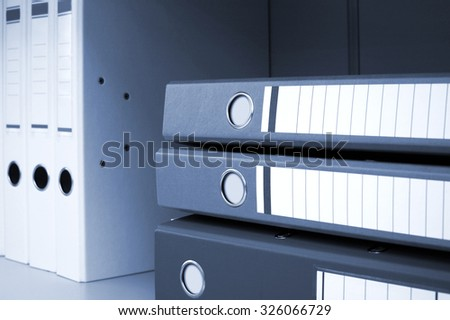 files for documents on a book shelf at office - stock photo