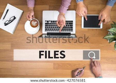 FILES man touch bar search and Two Businessman working at office desk and using a digital touch screen tablet and use computer, top view - stock photo