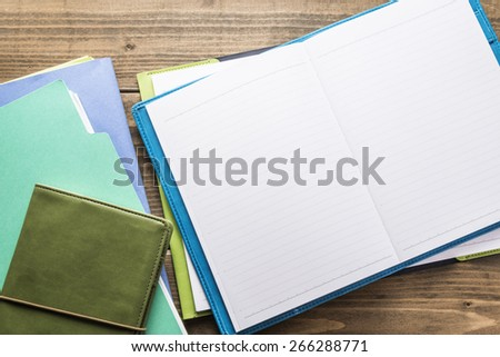 Files.Office wooden desk table with supplies. - stock photo