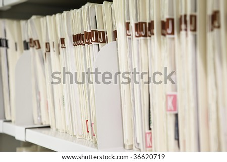 Files organized on shelf - stock photo