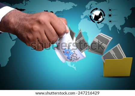 Files transferring from the tea cup - stock photo