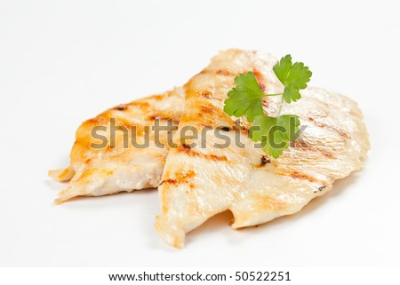 filet grilled chicken with tomato and parsley - stock photo