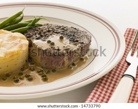 Filet Mignon au Poirve' with French Beans and Pomme Anna - stock photo