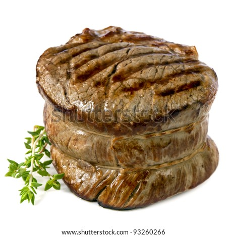 Filet mignon, chargrilled to perfection.  Isolated on white. - stock photo