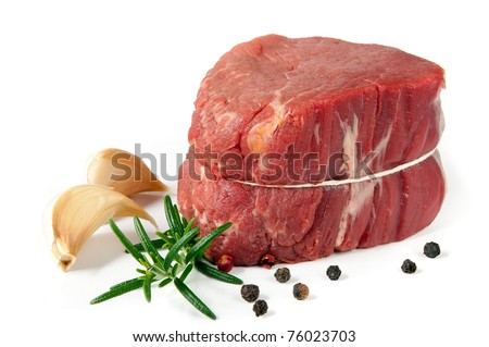 Filet mignon, ready for cooking, isolated on white background.  With garlic, rosemary and peppercorns.