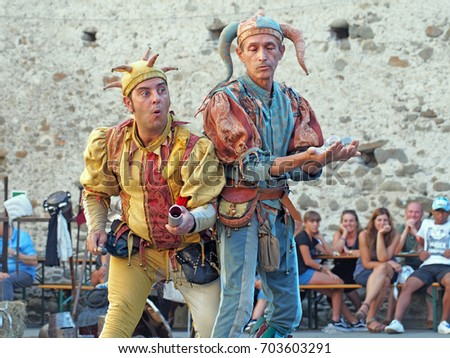 FILETTO, ITALY - AUGUST 15,2017: The annual Medieval market has assorted characters and street artists in a genuinely medieval village, Lunigiana, N Tuscany. Here jesters entertain with crystal balls.