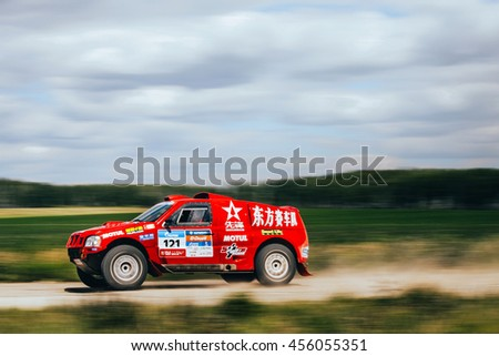 Filimonovo, Russia - July 11, 2016: motion blur rally car Chinese team rides on road during Silk way rally