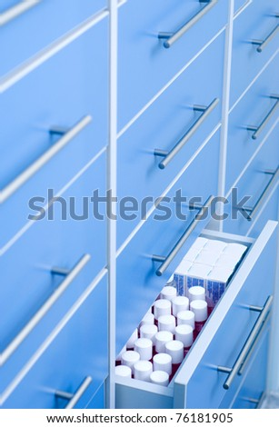 Filing cabinet with open drawer - stock photo