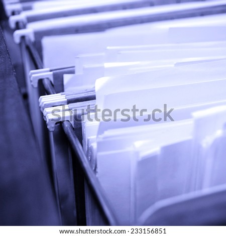 Filing Drawer full of files and boxes - stock photo