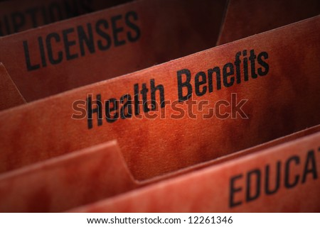 Filing folder featuring health benefits tab - stock photo