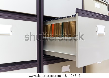 Filing for large folders in an office - stock photo