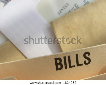 Filing system full of bills to pay. Concept of cost of living, financial pressures, debt. - stock photo