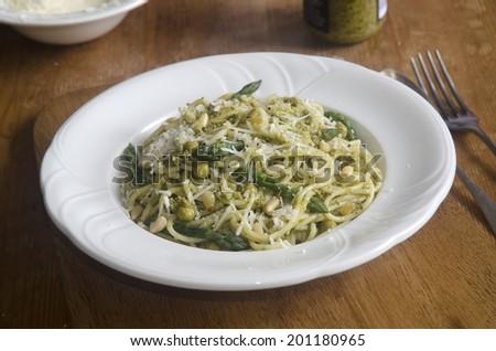 Filini pasta with asparagus, peas and pesto - stock photo