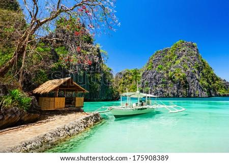 Filipino boat in the sea, Coron, Philippines - stock photo