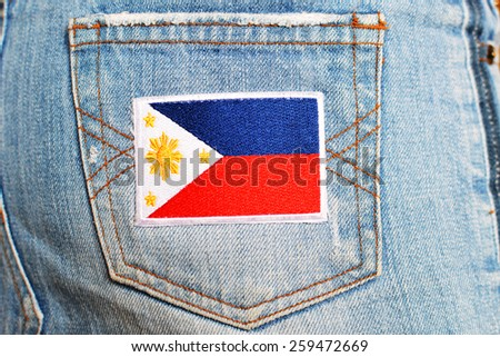 Filipino Flag Patch on an rear pocket of a jeans wear - stock photo