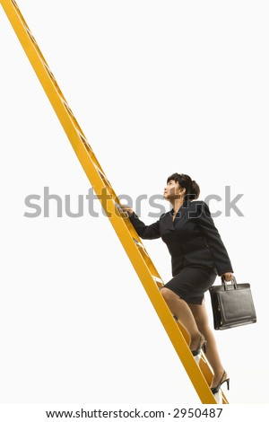 Filipino middle-aged businesswoman climbing ladder carrying briefcase. - stock photo