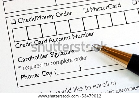 Fill in the credit card information in an order form - stock photo