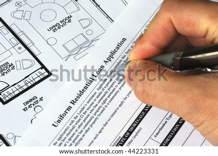 Fill in the mortgage application to buy a real estate property - stock photo