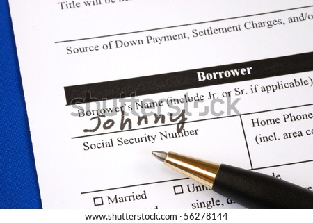 Fill out the home mortgage application form - stock photo