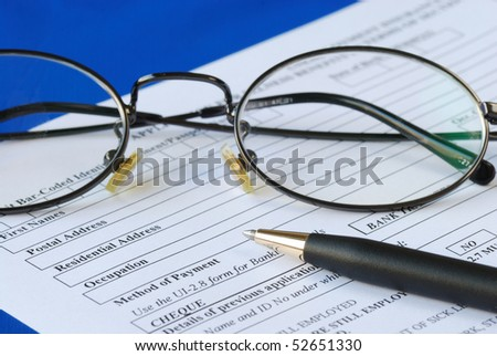 Fill out the personal information in an application isolated on blue - stock photo