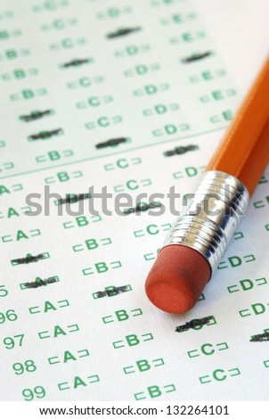 Fill the computer grade sheet with the pencil - stock photo