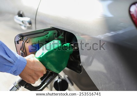 Fill the gas tank eco car self service - stock photo