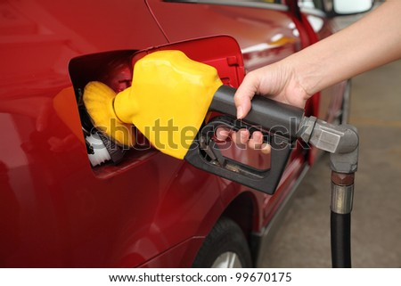 Fill up fuel at petrol station - stock photo