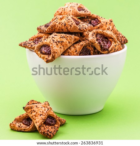 Filled cookies are made from rolled cookie dough filled with fruit or confectionery filling before baking. - stock photo