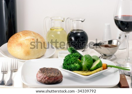 fillet mignon gourmet plate, with steamed vegetables .