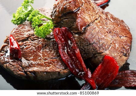 Fillet mignon red wine sauce with chili - stock photo