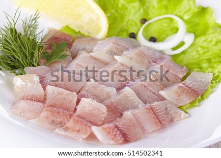 Fillet of a lightly salted grayling on a white plate