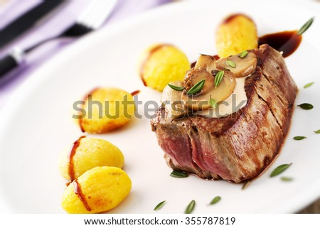 Fillet of beef with mushroom sauce and potatoes - stock photo