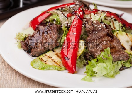 Fillet of beef with salad on a plate