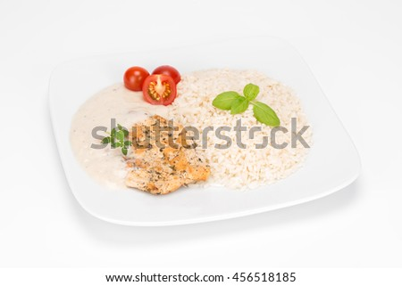 fillet of chicken saute with rice in bechamel sauce - stock photo