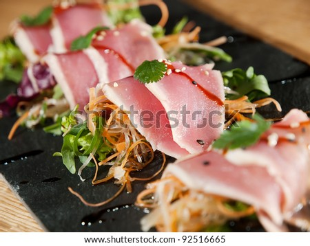 fillet of fish with salad - stock photo