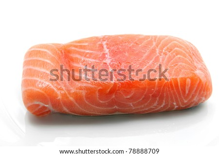 fillet of fresh raw salmon seafood ingredient on dish